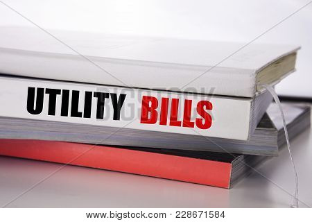 Writing Text Showing Utility Bills. Business Concept For Money Bill Payment Written On The Book The