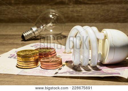 Ecological European Tube Bulb Placed On Czech Money