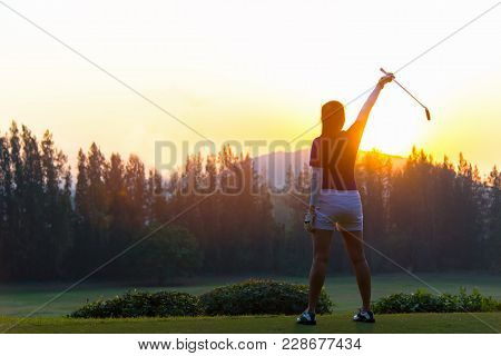 Golf Women.  Cheerful Happy Asian Smiling Woman With Playing Golf In The Golf Club In The Sunny And