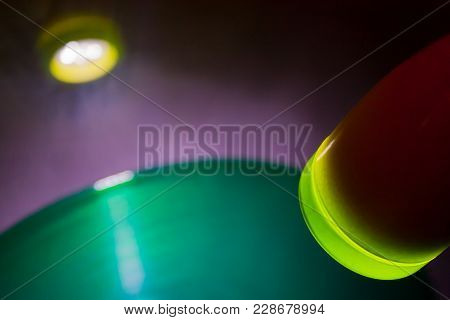 Red Lamp Shining On Green Vinyl Record On Grey Wall In Disco
