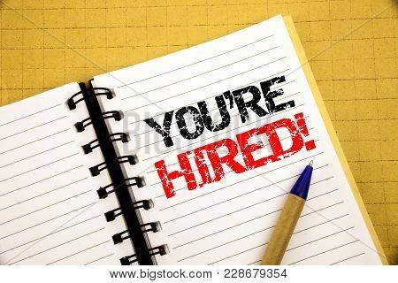 You Are Hired. Business Concept For Hiring Employee Worker Written On Notepad With Space On Old Wood