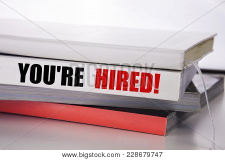 Writing Text Showing You Are Hired. Business Concept For Hiring Employee Worker Written On The Book
