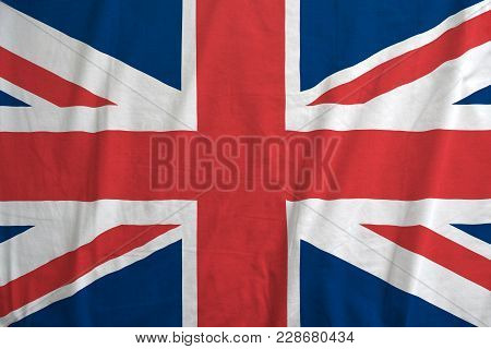British Flag Blowing In The Wind. Fabric Texture Of The Flag Of United Kingdom.