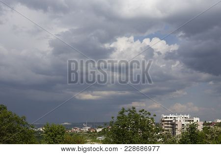 Dark Clouds On The City. Dark Clouds As A Background.