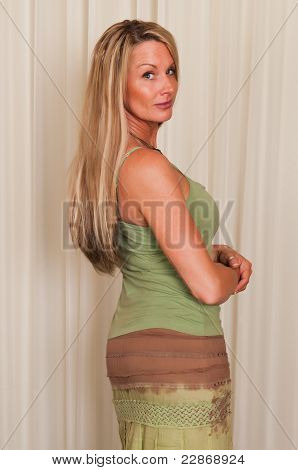 Beautiful mature blonde woman in hippie attire poster