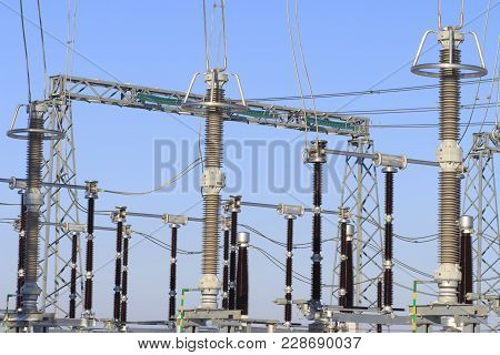Power High Voltage Electric Substation. Industrial Electrical Equipment On Power Station.