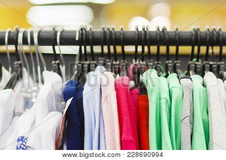 Clothes On Hangers In Row In Boutique Clothes. Clothing Store
