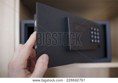 Man Opens Safe Depository Of Valuables And Money In His Home. Keep The Money In The Safe At Home. Sa