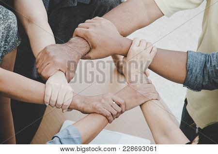 Team Work Concept; Close Up Of Joining Hands Of Businessman In Unity Cross Processing Background; Ex