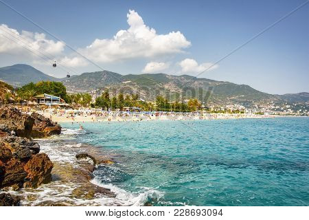 Tropical Beach Of Costa Brava On Sunny Summer Day. Paradise Lagoon On Seaside Resort Of Spain. Touri