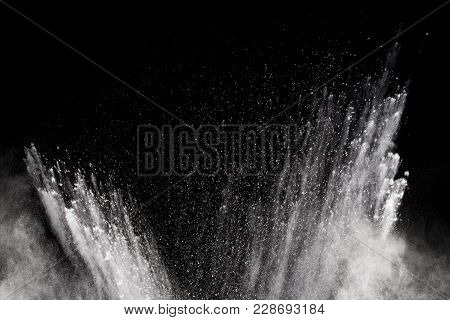 Freeze Motion Explosion Of White Dust On A Black Background.stopping The Movement Of White Powder On