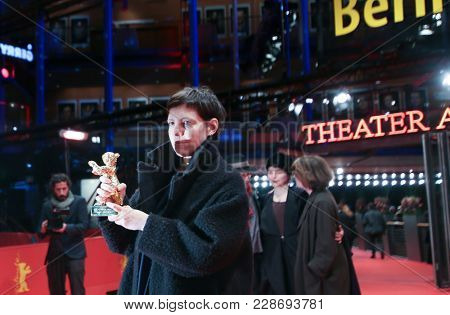 Adina Pintilie, winner of the Golden Bear for Best Film for 'Touch me not' poses after the closing ceremony during the 68th Film Festival Berlin at Palast on February 24, 2018 in Berlin, Germany