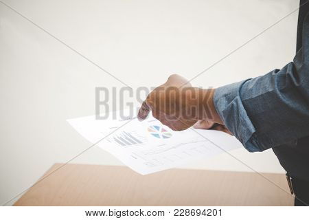 Manager Pointing The Sale Report Which Sale Staff Submit; Business Concept