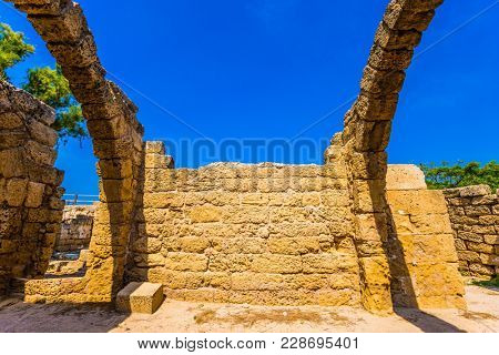 Israel. Spring sun illuminates the ruins of the covered arcades in Caesarea. Concept of ecological and historical tourism