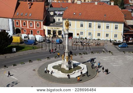 ZAGREB, CROATIA - APRIL 10: Holy Mary column (circa 1865) with angels and fountain in front of Zagreb Cathedral. Sculptor Dominik Fernkorn, architect Herman Bolle in Zagreb April 10, 2015