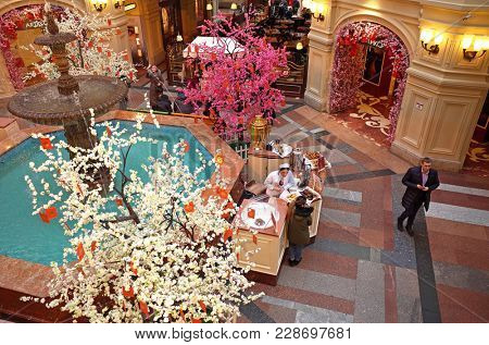 Russia, Moscow - February 15, 2018: small tea and coffee shop near fountain inside russian most famous and oldest State Department Store in Moscow GUM located on Red Square