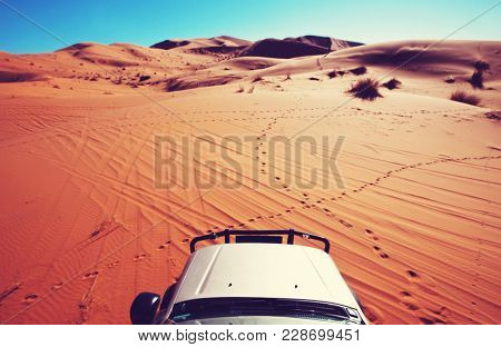4x4 vehicle driving off road in Sahara desert, Morocco, Africa