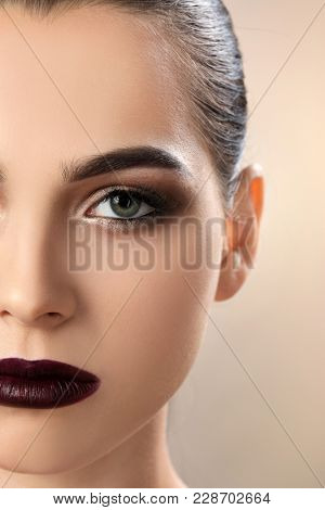 Woman with beautiful makeup on light background. Professional visage artist work