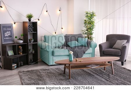 Elegant living room interior with comfortable sofa and table