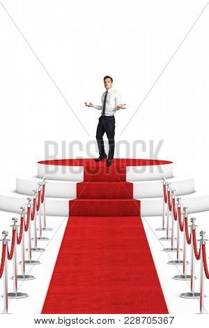 man on podium and red carpet with rope barrier