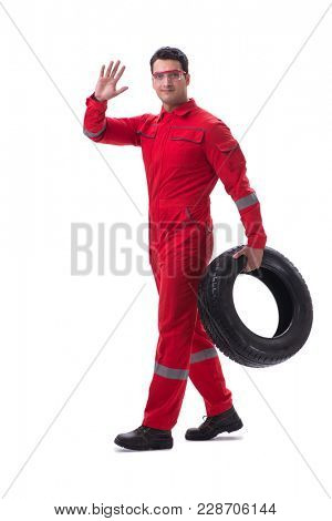 Young tyre repairman in red coveralls isolated on white backgrou