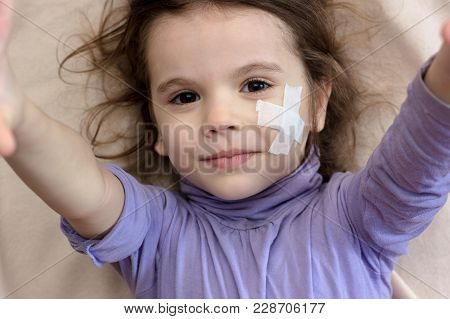 Little Kid Girl With Adhesive Band On Face Making Selfie
