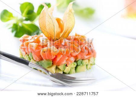 Salmon Tartar over White Background. Gourmet Food. Starter. Healthy dinner. Served table