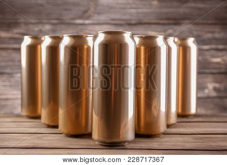 Cans of beer on wooden background