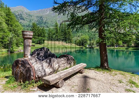 Natural spring water on small alpine Lake Laux in Piedmont, Northern Italy.
