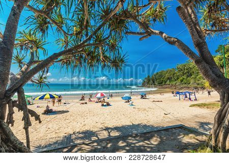 NOOSA, AUSTRALIA, FEB 17 2018: People enjoying summer at Noosa main beach - a famous tourist destination in Queensland, Australia.