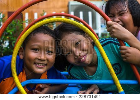 KOH CHANG, THAILAND - FEB 25, 2018: Local unknown children from the village on in Klong Song district. Ko Chang Island consisting of 8 villages with 5,356 inhabitants.