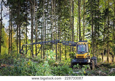 Jokioinen, Finland - September 15, 2017: Forestry Machine Operator Works In Forest With Ponsse Ergo