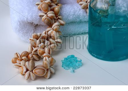 Spa essentials with shell necklace