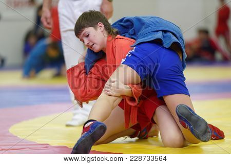 ST. PETERSBURG, RUSSIA - NOVEMBER 19, 2017: Young athletes competes in wrestling during the All-Russian Wrestling Day. The event is held annually since 2008