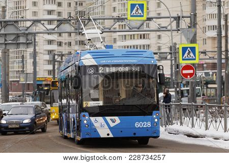 SAINT-PETERSBURG, RUSSIA - FEBRUARY 12, 2018: Trolleybus on line 2 at Komendantskaya square. This bus pass a half of his route using autonomous power supply