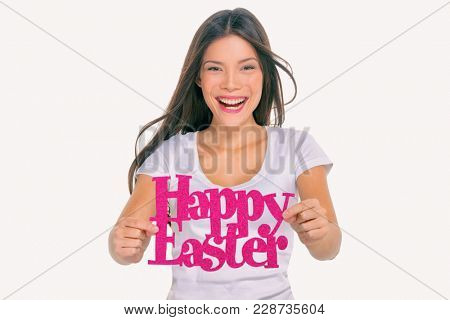 Happy Easter party sign young girl showing text signage. Asian woman holding cutout of title on studio background. For Easter holiday spring season celebration.