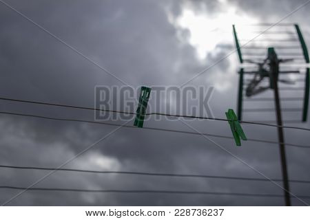 Clothesline On A Rainy Day With Television Antenna