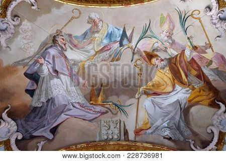 AMORBACH, GERMANY - JULY 08,2017: Amorbach abbots and bishops of Verden and Martyrs: Saint Tanco, Kortyla, Haruchus and Erlulphus fresco by Matthaus Gunther in Benedictine monastery church in Amorbach