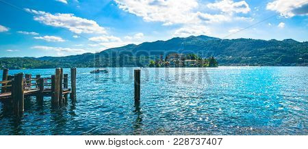 Orta Lake Landscape. San Giulio Island Isola View From The Ferry Dock. Piedmont, Italy, Europe.