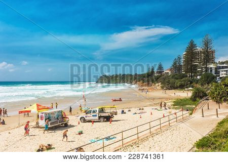 COOLUM, AUSTRALIA, FEB 18 2018: People enjoying summer at Coolum main beach - a famous tourist destination in Queensland, Australia.