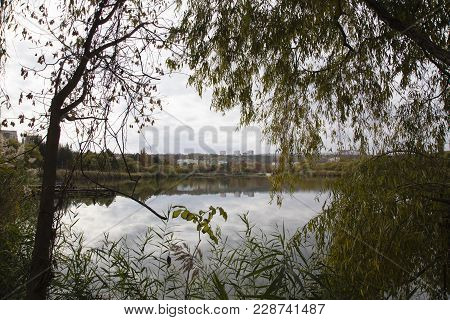 Autumn Urban Landscape. There Are A Townscape And A City Lake
