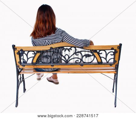 Back view of a woman sitting on a bench.  girl  watching. Rear view people collection.  backside view of person.  Isolated over white background. Brunette sits on bench throwing his arm over the back.