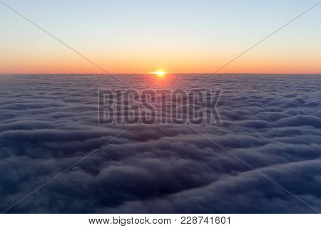 Clouds. bright morning dawn in the sky. sunset with a height of 10 000 km. Top view. leaving day. Bottom night, another day on top, lit the departing sun.
