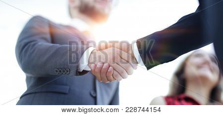 Successful business people handshaking after good deal.