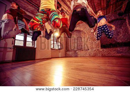 Young modern dancing group practice dancing in jump