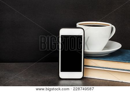 Black Board, Smartphone, Book, Cup Coffee Or Tea With Copy Space