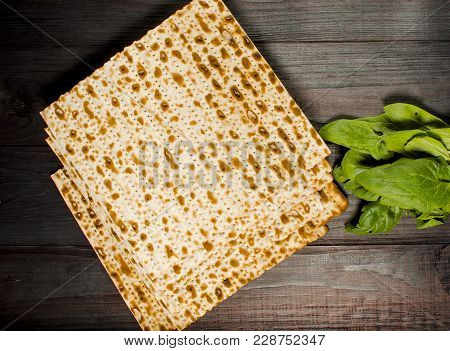 Traditional Jewish Kosher Matzo For Easter Pesah On A Wooden Table. Jewish Easter Food. Spring.famil