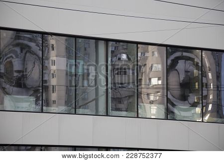 House Reflected In A Window. Background Of A Continuous Lights.