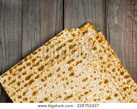 Traditional Jewish Kosher Mazzo. Family Holiday Pesach. Spring. Eating Matzah