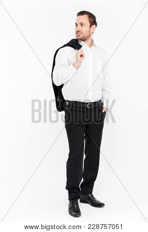 Full-length portrait of good-looking employer smiling and looking aside holding black jacket in hand isolated over white background